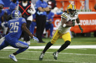 Green Bay Packers wide receiver Davante Adams (17) pulls away from Detroit Lions strong safety Duron Harmon (26) during the first half of an NFL football game, Sunday, Dec. 13, 2020, in Detroit. (AP Photo/Leon Halip)