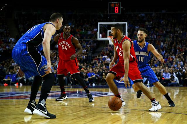 LONDON, ENGLAND - JANUARY 14: Cory Joseph #6 of the Toronto Raptors dribbles past Evan Fournier #10 of the Orlando Magic during the 2016 NBA Global Games London match between Toronto Raptors and Orlando Magic at The O2 Arena on January 14, 2016 in London, England. (Photo by Clive Rose/Getty Images)