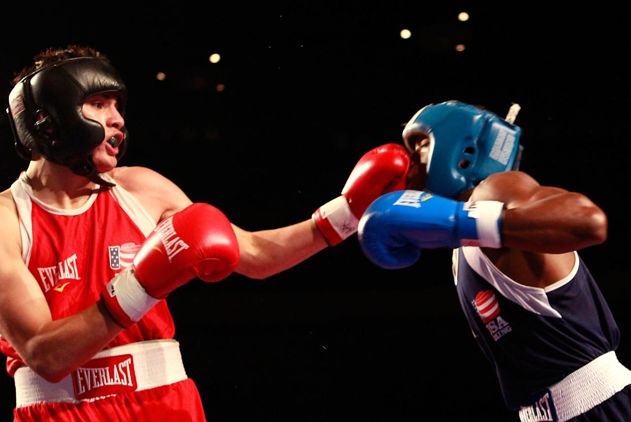 MOBILE, AL - AUGUST 05:  Jose Ramirez (red) lands a punch on Raynell Williams (blue) during the 2012 U.S. Men's Boxing Olympic Team Trials at the Mobile Civic Center on August 5, 2011 in Mobile, Alabama.  Ramirez defeated Williams in a decision.  (Photo by Kevin C. Cox/Getty Images)