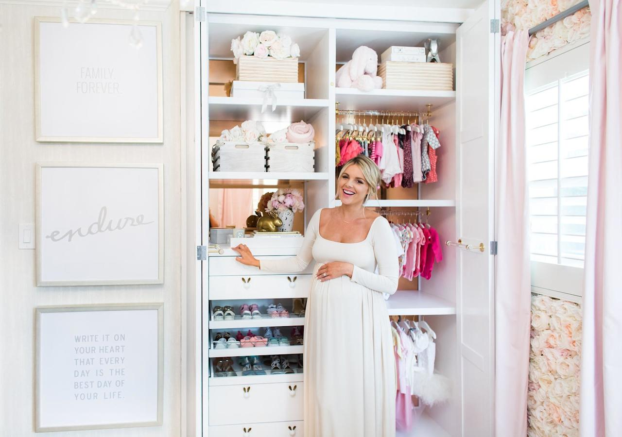 "<p>What's pink, white, and sweet all over? Other than Ali Fedotowsky's new daughter Molly, it's her nursery, which was created with the help of <a rel=""nofollow"" href=""http://www.vanessaantonelli.com/"">Vanessa Antonelli</a>. The designer checked out the celeb mama's Instagram posts and saw photos in her home showing ""beautiful, feminine, and frilly"" things. ""Immediately, a design started dancing in my head featuring the floral focal wall,"" Antonelli says. In fact, Ali's style isn't very girlie—but Antonelli says she still loved the inspiration, ""and her nursery was created around that gorgeous wall from The Flower Wall Company featuring thousands of handmade flowers."" Also worthy of envy: Baby Molly's amazing closet, designed by LA Closet Design!</p>"