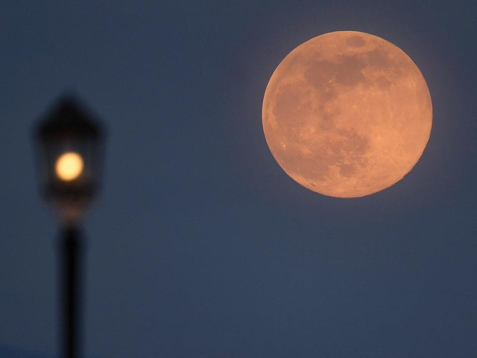 A supermoon rises over Worthing pier on 7 April, 2020 in Worthing, United Kingdom (Getty Images)