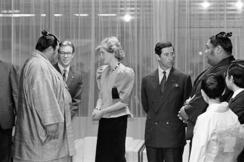 Charles and Diana meeting sumo wrestlers in 1986 - Credit: GETTY