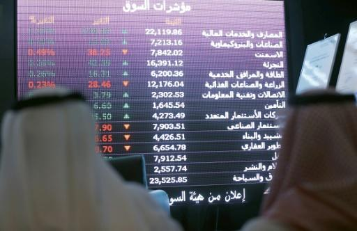 A file picture shows Saudi investors monitoring stock market prices in Riyadh