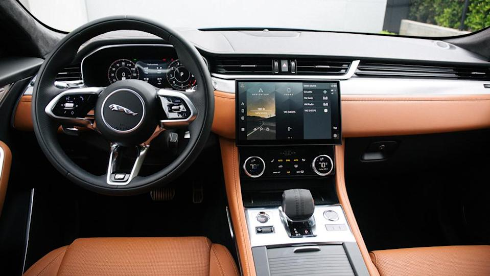 The F-Pace's interior receives a major improvement with a dashboard that is now identical with the one on the new XF. - Credit: Jaguar Land Rover Automotive PLC.