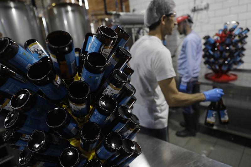 Beer producers in Lebanon face challenges, mostly due to a need to import ingredients such as hops, and the need to import bottles as the country has no glass industry (AFP Photo/Joseph EID)