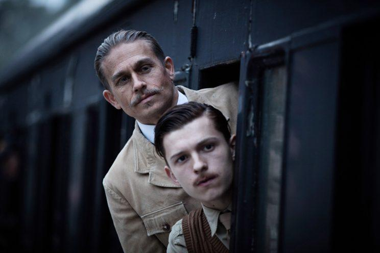 Charlie Hunnam and Tom Holland in dueling mustaches.