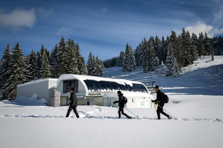 The ski lifts are open on the Swiss side but skiers can't reach them because the car park is off limits