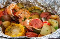 """<p>Foil packets are perfect camping recipes because they're easy to assemble and there's little to no clean up.</p> <p>For a Cajun-inspired flavour bomb, try this <a href=""""https://www.freshoffthegrid.com/shrimp-boil-foil-packets/"""" rel=""""nofollow noopener"""" target=""""_blank"""" data-ylk=""""slk:Shrimp Boil Foil Packet"""" class=""""link rapid-noclick-resp"""">Shrimp Boil Foil Packet</a> on your next camping trip. As the recipe states, it's important to include ingredients that cook at the same rate. While potatoes are a popular seafood boil ingredient, they cook slowly so you would need to pre-boil them before adding them to the packet.</p> <p>Assemble all your ingredients and seasonings into a pack lined with parchment paper and foil. Wrap and seal the package so the juices don't leak and cook for 8-10 minutes.</p>"""