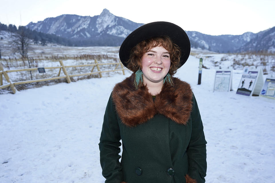 Bryleigh McCarty is shown in Chautauqua Park late Wednesday, Jan. 27, 2021, in Boulder, Colo. The 21-year-old, who has recovered from a case of a COVID-19, is working at a local school after losing her previous job—managing a yarn store—because of the effects on the economy because of the spread of the virus last year. (AP Photo/David Zalubowski)