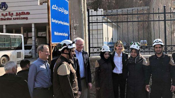 PHOTO:U.S. Ambassador to the United Nations Kelly Craft and James Jeffrey, the U.S. envoy for Syria, pose with rescue workers at the Syrian crossing point of Bab al-Hawa near Turkey's Cilvegozu border gate, in Idlib governorate, Syria, March 3, 2020. (Tuvan Gumrukcu/Reuters)