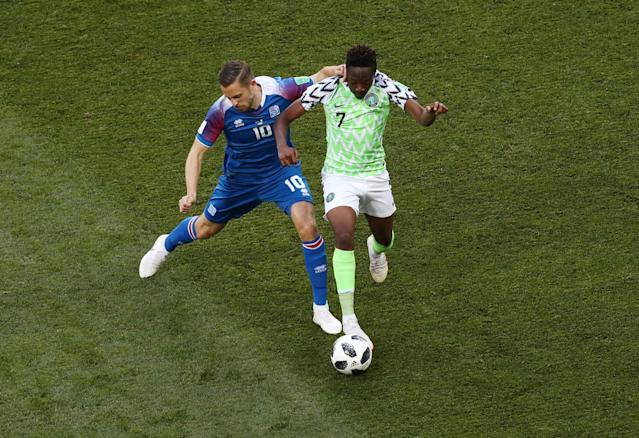 Soccer Football - World Cup - Group D - Nigeria vs Iceland - Volgograd Arena, Volgograd, Russia - June 22, 2018 Nigeria's Ahmed Musa in action with Iceland's Gylfi Sigurdsson REUTERS/Sergio Perez