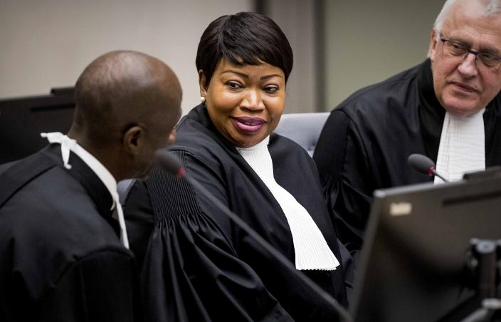 FILE - In this Friday, Jan. 25, 2019, file photo, prosecutor Fatou Bensouda, center, confers with colleagues during her first audience at the International Criminal Court in The Hague, Netherlands. Bensouda addressed the United Nations Security Council virtually on Wednesday June 9, 2021, in her final briefing to the council. (Koen Van Well/Pool Photo via AP, File)