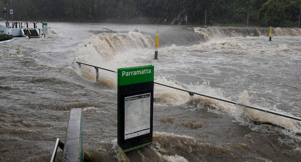 The Parramatta River broke at the Charles St weir and ferry wharf Saturday morning. Source: AAP