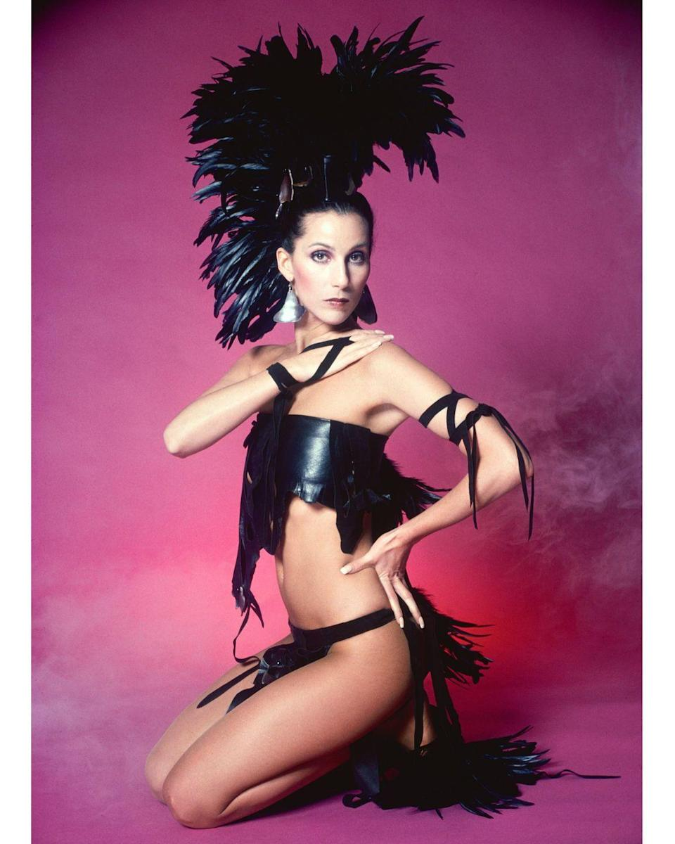 <p>Modeling a black feathered and leather Bob Mackie design. </p>