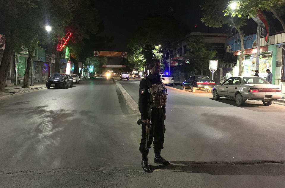 An Afghan policeman stands guard at the site of a bombing in a mosque in Kabul, Afghanistan, Tuesday, June 2, 2020. Tariq Arian, spokesman for the Afghan interior ministry says the the attack has taken place inside the compound of Wazir Akber Khan Mosque on the Tuesday evening. (AP Photo/Rahmat Gul)