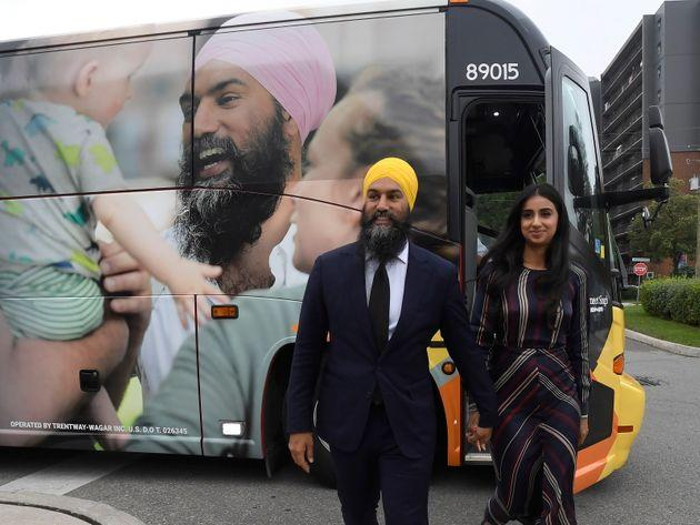 NDP Leader Jagmeet Singh and his wife Gurkiran Kaur Sidhu stand by his campaign bus in London, Ont., on Sept.11, 2019.