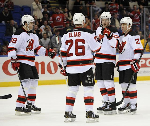 New Jersey Devils' Jaromir Jagr (68), Patrik Elias (26), Eric Gelinas (22) and Marek Zidlicky (2) celebrate Gelinas's goal against the New York Islanders in the third period of an NHL hockey game on Saturday, March 1, 2014, in Uniondale, N.Y. The Devils won 6-1. (AP Photo/Kathy Kmonicek)