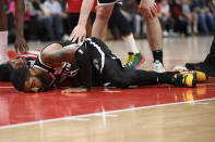 Brooklyn Nets guard Kyrie Irving lies on the court after he was injured during the second half of an NBA basketball game against the Washington Wizards, Saturday, Feb. 1, 2020, in Washington. (AP Photo/Nick Wass)