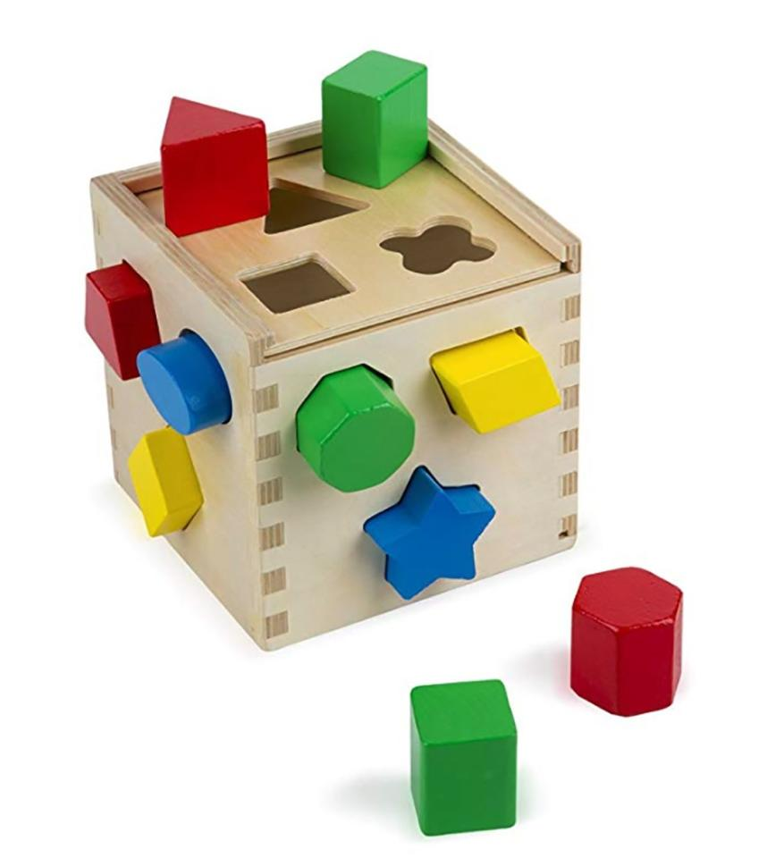 """<p><strong>Why she'll love it:</strong>Sorting shapes is trial and error at its most basic.</p> <p><strong>Why experts love it:</strong>""""Children work on hand-eye coordination and learn how objects with similar properties go together,"""" says Joyce Nuner, PhD, assistant professor of child development and family studies at Baylor University in Waco, Texas.</p> <p><strong>Our pick:</strong>This adorable wooden boxcomes with all the requisite shapes, so your kid gets a start at learning those too. Since the pieces are stored inside, he'll learn how to clean up when he's done.</p> <p><a rel=""""nofollow"""" href=""""https://www.amazon.com/Melissa-Doug-Shape-Sorting-Cube/dp/B00005RF5G/ref=as_li_ss_tl?ie=UTF8&linkCode=ll1&tag=mparlifebestgiftsforoneyearoldslhoct18-20&linkId=82f9d3b37ce8ebe3cc225a99133e11f6"""">Shop This</a></p>"""