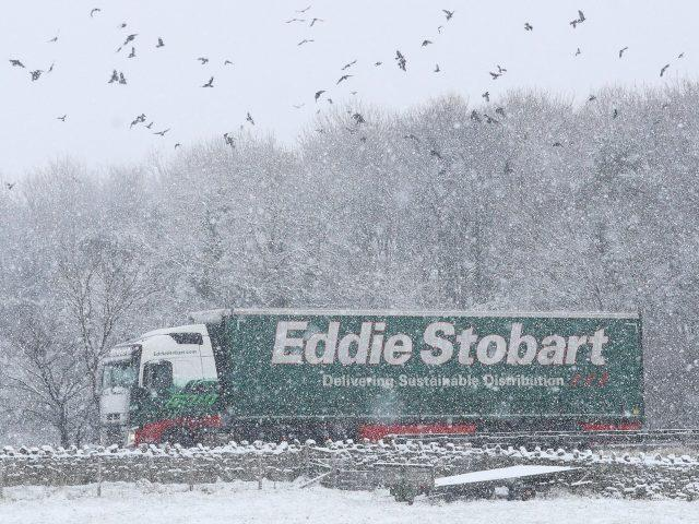 An Eddie Stobart lorry passes through heavy snow on the A66 in the North Pennines (Owen Humphreys/PA)