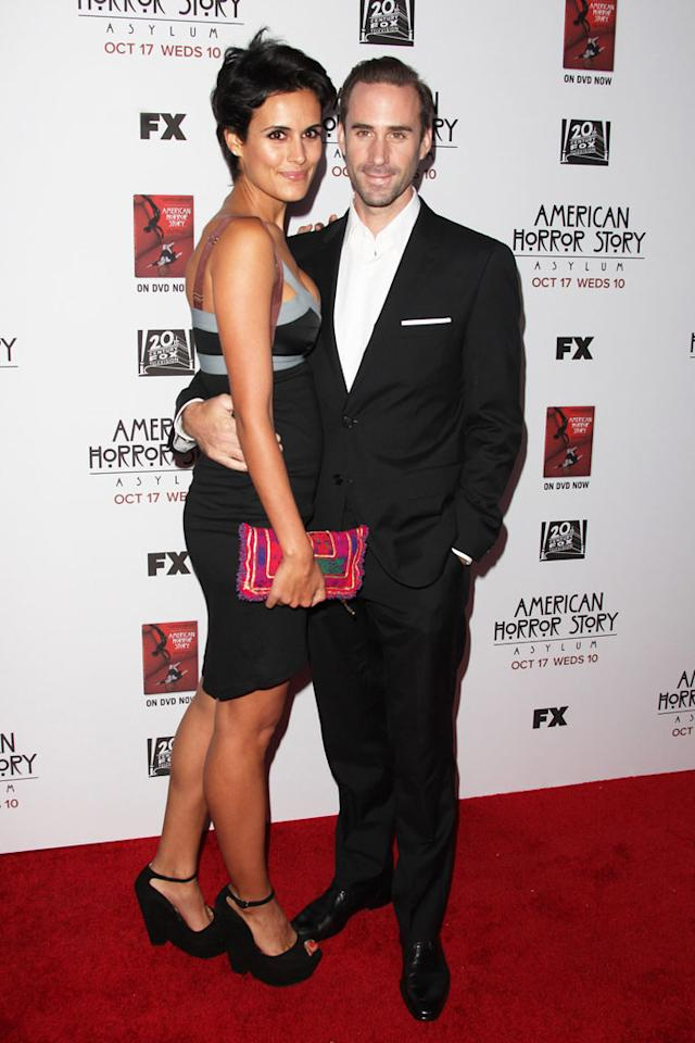 "Joseph Fiennes and guest attend the ""American Horror Story: Asylum"" premiere held at Paramount Studios on October 13, 2012 in Hollywood, California."