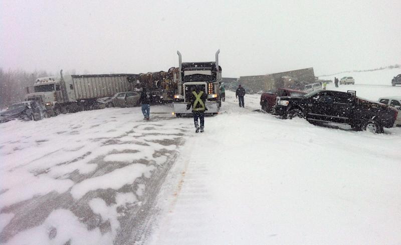 Vehicles litter the highway as more than 300 people have been injured following a multi-vehicle crash in snowy conditions, Thursday, March 21, 2013 on Highway 2 south of Edmonton, Alberta. A blizzard sweeping across the Canadian plains caused a chain of traffic wrecks involving a bus, semi-trailer trucks and cars south of Edmonton, Alberta, sending about 300 injured travelers to hospitals on Thursday, officials said. (AP Photo/The Canadian Press, Derek Fildebrandt)