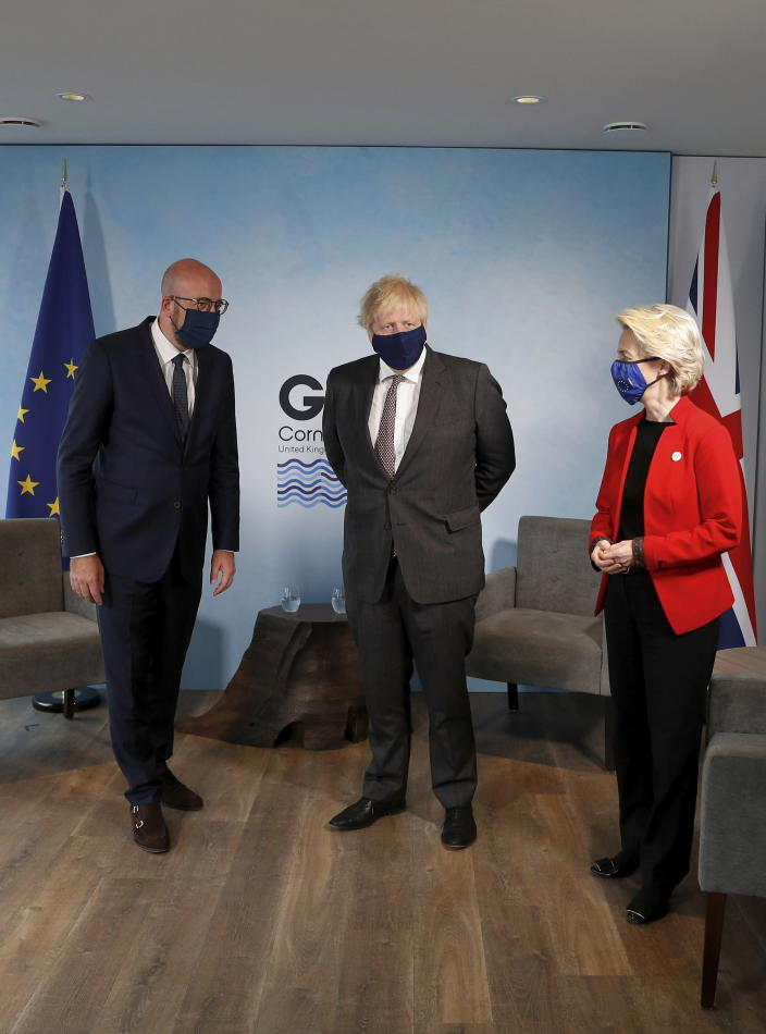 Britain's Prime Minister Boris Johnson, center, meets with European Commission President Ursula von der Leyen and European Council President Charles Michel, left, during the G7 summit in Cornwall, England, Saturday June 12, 2021. (Peter Nicholls/Pool via AP)