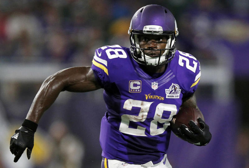 FILE - In this Sept. 18, 2016, file photo, Minnesota Vikings running back Adrian Peterson carries the ball during the first half of an NFL football game against the Green Bay Packers in Minneapolis. The Vikings on Tuesday, Feb. 28, 2017. have declined to exercise their option for next season on Peterson's contract. This makes the franchise's all-time leading rusher an unrestricted free agent when the market opens next week. (AP Photo/Andy Clayton-King, File)