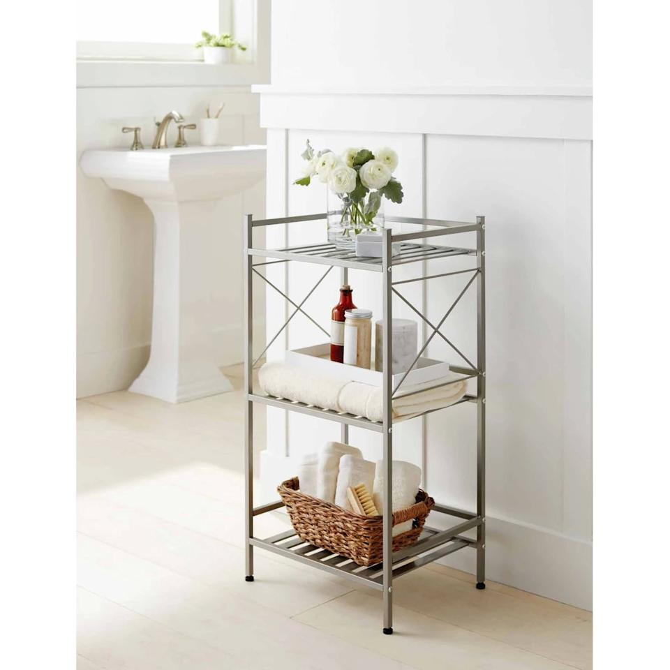 """<p>Keep your bathroom basics in easy reach with this <a href=""""https://www.popsugar.com/buy/Square-Tube-3-Tier-Decorative-Storage-Cabinet-472189?p_name=Square%20Tube%203-Tier%20Decorative%20Storage%20Cabinet&retailer=target.com&pid=472189&price=35&evar1=casa%3Aus&evar9=46417510&evar98=https%3A%2F%2Fwww.popsugar.com%2Fhome%2Fphoto-gallery%2F46417510%2Fimage%2F46419112%2FSquare-Tube-3-Tier-Decorative-Storage-Cabinet&list1=target%2Cfurniture%2Cbathrooms&prop13=api&pdata=1"""" rel=""""nofollow"""" data-shoppable-link=""""1"""" target=""""_blank"""" class=""""ga-track"""" data-ga-category=""""Related"""" data-ga-label=""""https://www.target.com/p/square-tube-3-tier-decorative-storage-cabinets-brushed-nickel-threshold-153/-/A-53049100"""" data-ga-action=""""In-Line Links"""">Square Tube 3-Tier Decorative Storage Cabinet</a> ($35).</p>"""