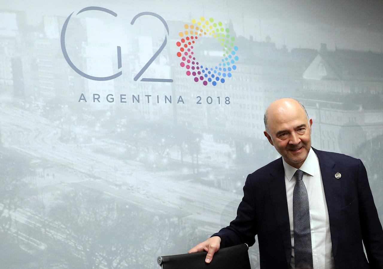 European Commissioner for Economic and Financial Affairs Pierre Moscovici arrives for a news conference at the G20 Meeting of Finance Ministers in Buenos Aires, Argentina, July 22, 2018. REUTERS/Marcos Brindicci