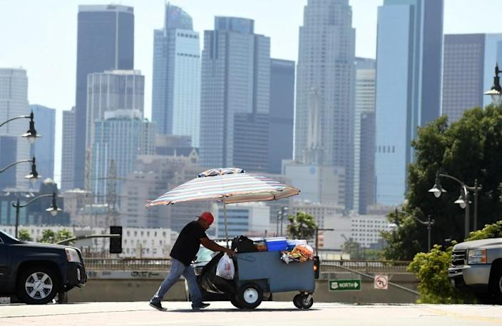 -ME- June 14, 2021: A vendor walks in East L.A. during a heat wave in Southern California Monday. (Wally Skalij / Los Angeles Times)