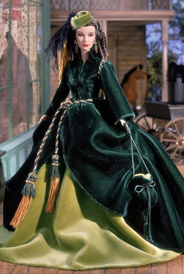 "<div class=""caption-credit""> Photo by: barbiecollector.com</div><b>Scarlett O'Hara doll, released in 2001 for $79</b> <br> Looks a lot like Vivien Leigh in ""Gone with the Wind,"" don't you think? And those banana curls! <br>"