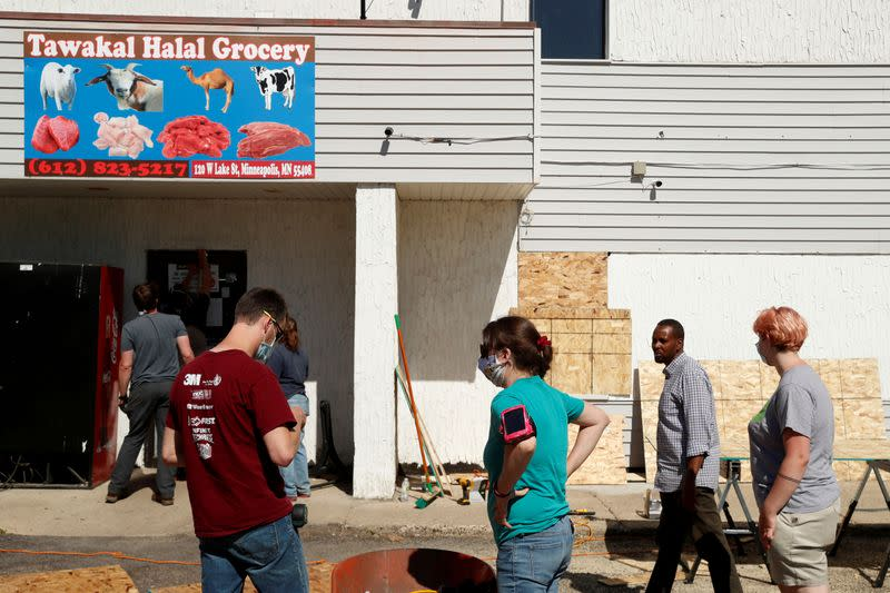 FILE PHOTO: People are seen outside Tawakal Halal Grocery store following the protests against the death in Minneapolis police custody of George Floyd, in Minneapolis