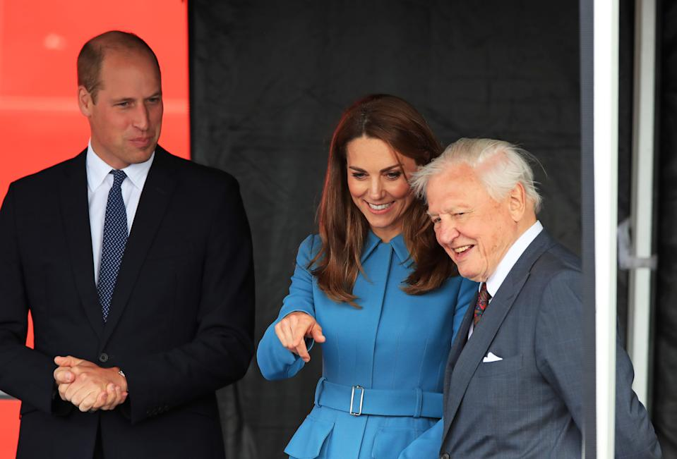 Britain's Prince William, Duke of Cambridge, (C), Britain's Catherine, Duchess of Cambridge (L) and Sir David  Attenborough (R) attend the naming ceremony of Britain's new polar research ship, the RRS Sir David Attenborough in Birkenhead, northwest England on September 26, 2019. (Photo by Peter Byrne / POOL / AFP)        (Photo credit should read PETER BYRNE/AFP via Getty Images)