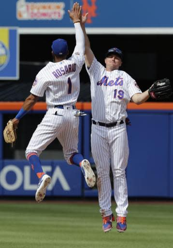 New York Mets' Amed Rosario (1) celebrates with teammate Jay Bruce (19) after a baseball game against the Arizona Diamondbacks, Sunday, May 20, 2018, in New York. (AP Photo/Frank Franklin II)