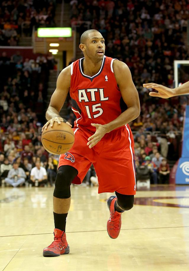 CLEVELAND, OH - DECEMBER 26: Al Horford #15 of the Atlanta Hawks handles the ball in the first half against the Cleveland Cavaliers at Quicken Loans Arena on December 26, 2013 in Cleveland, Ohio. (Photo by Mike Lawrie/Getty Images)