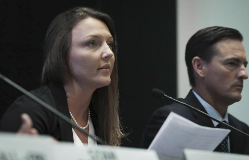 FILE - In this July 16, 2019 file photo, Courtney Wild, left, joined by her attorney Brad Edwards, reads a statement during a news conference in New York calling on victims of Jeffrey Epstein to contact the FBI or lawyers with their information. Epstein's accusers have suffered a setback in seeking money from the government over a plea deal that spared the financier a lengthy prison term. U.S. District Judge Kenneth Marra ruled on Monday, Sept. 16, 2019 that the government doesn't owe them money for it. (AP Photo/Bebeto Matthews, File)