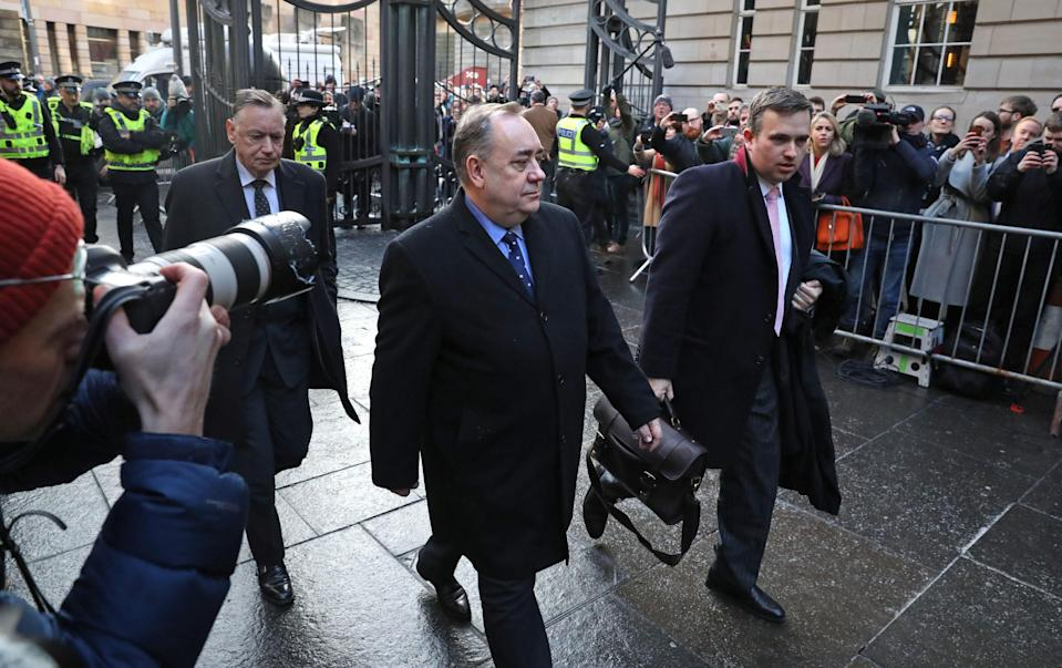 There was a substantial police and media prescence when Mr Salmond arrived outside court on Thursday. (PA)