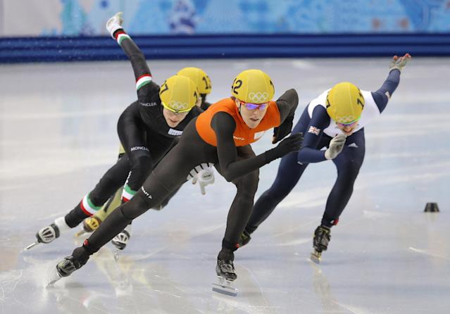 Jorien ter Mors of the Netherlands leads the field in a women's 500m short track speedskating heat at the Iceberg Skating Palace during the 2014 Winter Olympics, Monday, Feb. 10, 2014, in Sochi, Russia. (AP Photo/Vadim Ghirda)