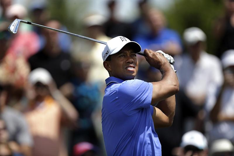 Tiger Woods tees off on the fourth hole during practice rounds of the Players Championship golf tournament at TPC Sawgrass in Ponte Vedra Beach, Fla., Tuesday, May 7, 2013. (AP Photo/Gerald Herbert)