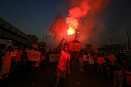 Protesters in Khartoum on July 4 rally in solidarity with people in parts of Darfur province following recent incidents of killings and looting there