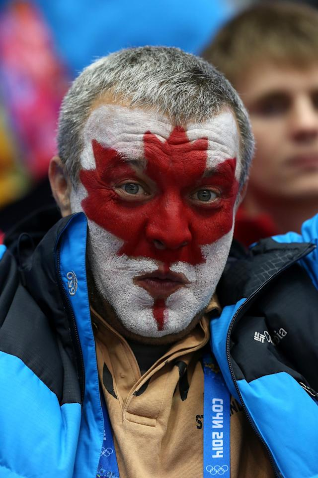 SOCHI, RUSSIA - FEBRUARY 21: A Canada fan attends the Men's Ice Hockey Semifinal Playoff between Canada and the United States on Day 14 of the 2014 Sochi Winter Olympics at Bolshoy Ice Dome on February 21, 2014 in Sochi, Russia. (Photo by Bruce Bennett/Getty Images)