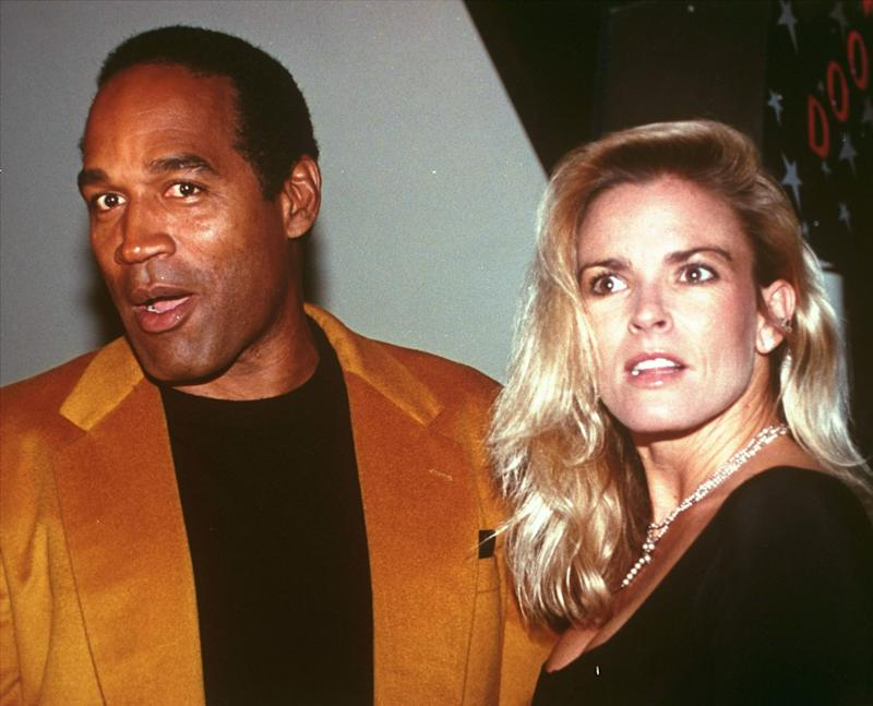 O.J. Simpson and his wife, Nicole Brown Simpson, celebrate the opening of the Harley-Davidson Cafe in this Oct. 19, 1993 file photo. (AP Photo/Paul Hurschmann)
