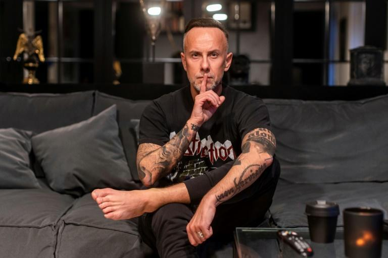 A Polish court ordered heavy metal star Adam Darski to pay a fine for posting a photo of himself stamping on an image of the Virgin Mary