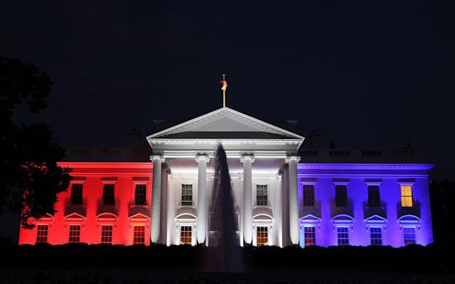 The White House is bathed in red, white and blue light as part of the Fourth of July celebration - Getty