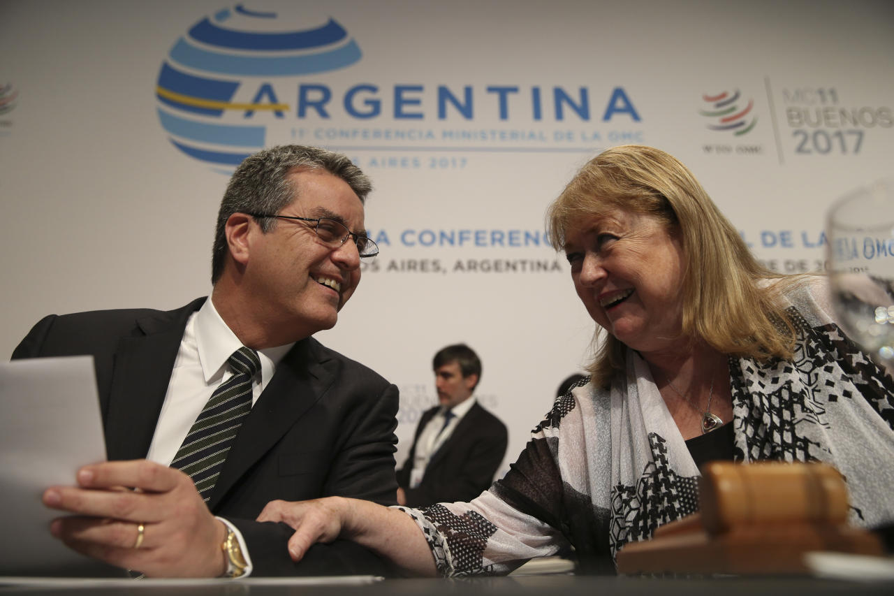 World Trade Organization Director General Roberto Azevedo, left, and WTO Ministerial Conference President Susana Malcorra talk during the closing ceremony of the WTO Ministerial Conference in Buenos Aires, Argentina, Wednesday, Dec. 13, 2017. (AP Photo/Natacha Pisarenko)