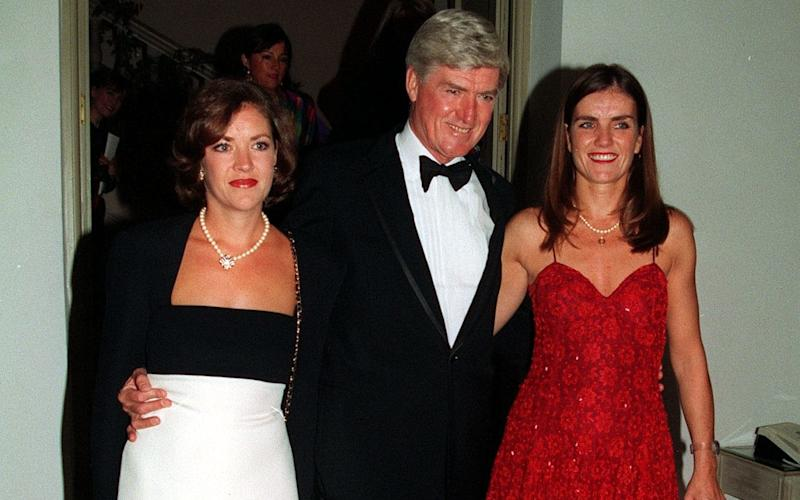 Lord Cecil Parkinson with daughters Mary, right, and Joanna, left, at a charity event in 1994 - Press Association Images