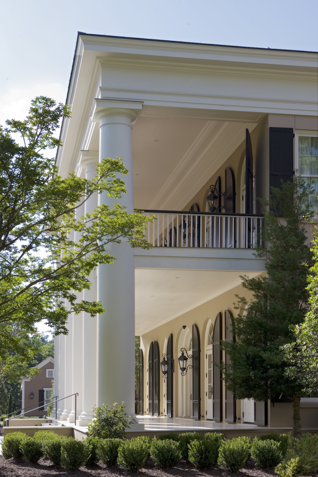 """<p>The Doric order columns on this Greek revival main house in coastal South Carolina are pristine examples of authentic, old-world craftsmanship designed by the architects at <a href=""""https://www.historicalconcepts.com/"""" target=""""_blank"""">Historical Concepts</a>. The double gallery porches feature operating louvered shutters on each pair of arched French doors. </p>"""