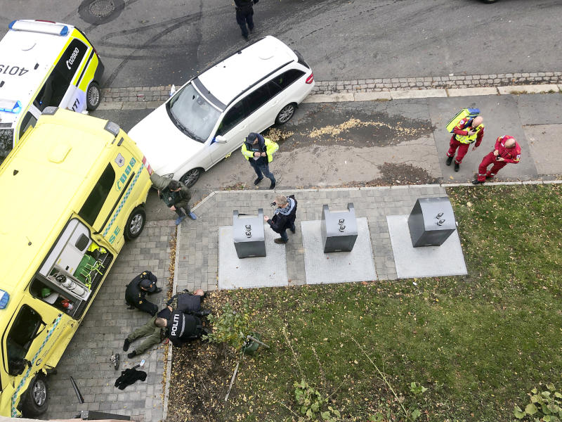Police detain a main, bottom left laying on the ground, next to a damaged ambulance that he stole after an incident in the center of Oslo, Tuesday, Oct. 22, 2019. Norwegian police opened fire on an armed man who stole an ambulance in Oslo and reportedly ran down several people. (Cathrine Hellesoy, Aftenposten via AP) NORWAY OUT, SWEDEN OUT, DENMARK OUT