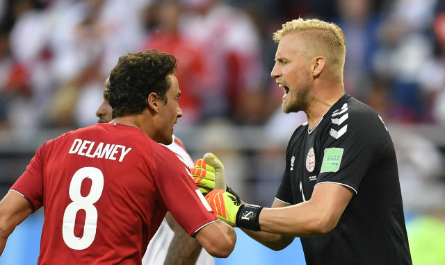 Denmark goalkeeper Kasper Schmeichel, right, reacts after save a penalty kick during the group C match between Peru and Denmark at the 2018 soccer World Cup in the Mordovia Arena in Saransk, Russia, Saturday, June 16, 2018. (AP Photo/Martin Meissner)